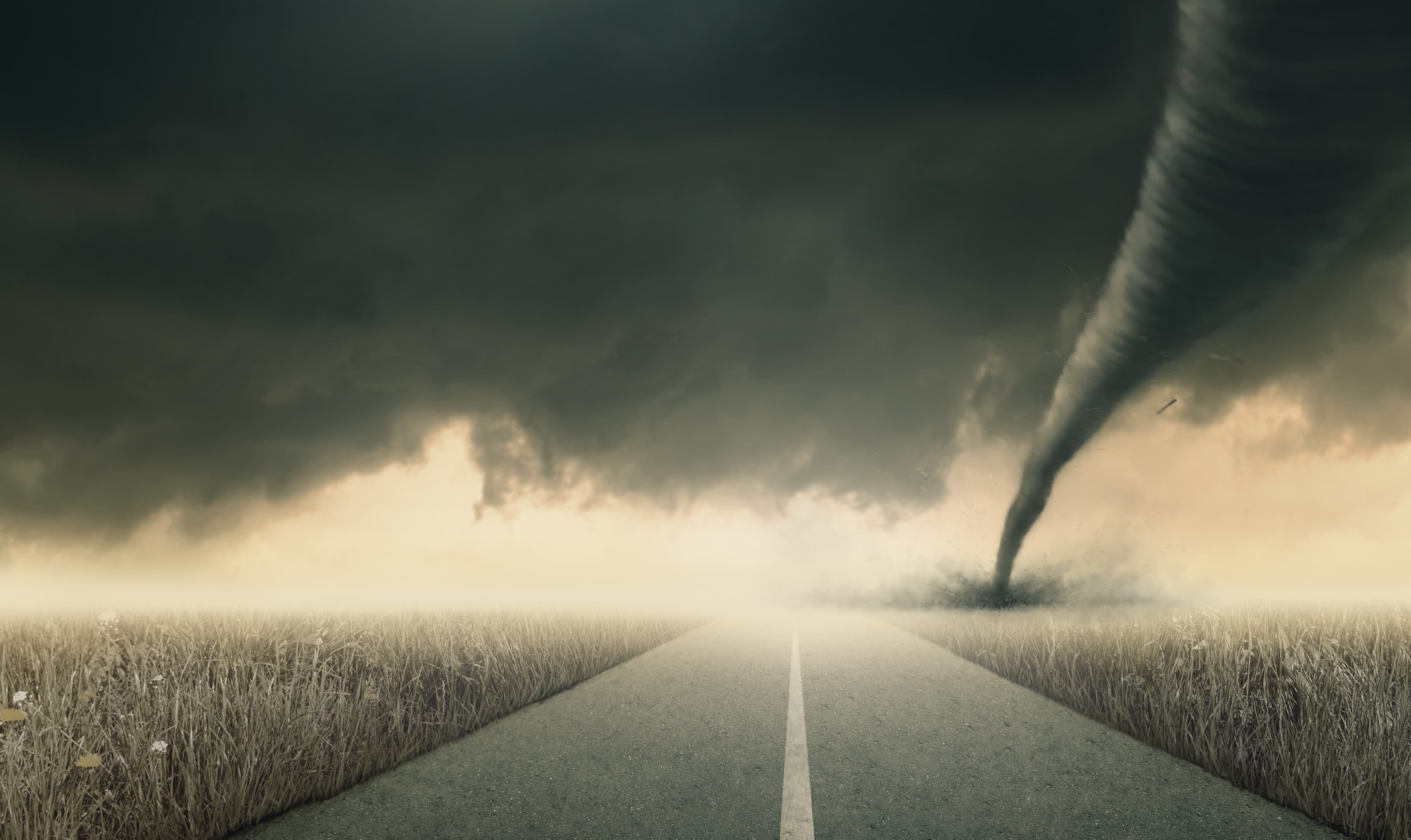 Tornado In Field Near Road